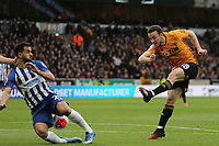 Diogo Jota of Wolverhampton Wanderers has a shot blocked by Martín Montoya of Brighton & Hove Albion during Wolverhampton Wanderers vs Brighton & Hove Albion, Premier League Football at Molineux on 7th March 2020