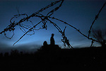 A tangled strand of barbed wire is all that seperates the Minuteman Project volunteers from Mexico near Naco, Mexico on Saturday, April 2, 2005. The Minuteman Project is an all-volunteer group monitoring the US/Mexico border in Arizon for the month of April, reporting all illegal border crossers to the US Border Patrol.<br />