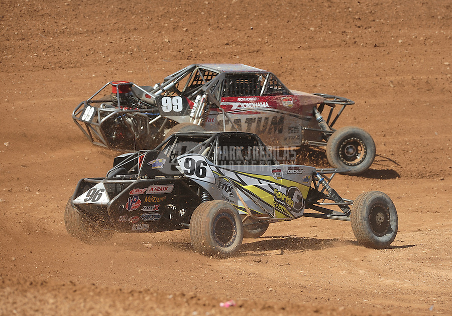 Apr 17, 2011; Surprise, AZ USA; LOORRS driver Rich Ronco (99) leads Doug Fortin (96) during round 4 at Speedworld Off Road Park. Mandatory Credit: Mark J. Rebilas-