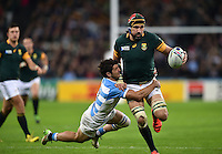 Victor Matfield of South Africa is tackled in possession. Rugby World Cup Bronze Final between South Africa and Argentina on October 30, 2015 at The Stadium, Queen Elizabeth Olympic Park in London, England. Photo by: Patrick Khachfe / Onside Images