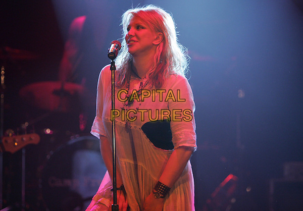 COURTNEY LOVE.Perform at The Camp Freddy South East Asia Tsunami Relief Fund Benefit held at The Key Club in West Hollywood, California .January 27th, 2005.half length, stage, gig, concert, white dress.www.capitalpictures.com.sales@capitalpictures.com.Supplied By Capital PIctures