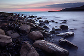 The last glimmers of light over Kimmeridge Bay, Dorset
