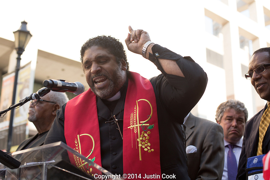 The Rev. William Barber II leads the first Moral Monday of 2014 at Bicentennial Plaza, the North Carolina Legislative building and Halifax Mall in Raleigh , N.C. on Monday, May 19, 2014. (Justin Cook)<br /> <br /> Since 2013 hundreds of people have gathered on Mondays when the North Carolina Legislature is in session to peacefully protest what they feel is a an extreme conservative agenda that endangers education, the poor, the unemployed, voting rights and organized labor in North Carolina. Many of the nonviolent protestors deliberately get arrested in acts of civil disobedience.