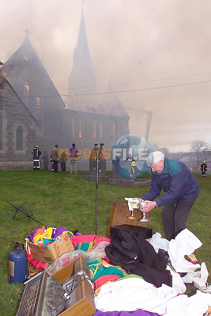 Locals help to remove items from The Church of Our Lady of Imaculate Conception in Louth village  while members of the fire service from Dundalk, Drogheda, Dunleer and Ardee fire service tackled fire. Picture Fran Caffrey/Newsfile