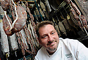 Donald Link, chef of Herbsaint and Cochon, poses with his sausage in his office at Herbsaint as he awaits the opening of his new butcher shop, New Orleans, Monday, Jan. 12, 2009.