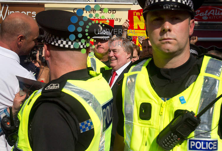 John Prescott flanked by police Scotland on referendum campaign. The Labour veteran was joined by Alistair Darling and Anas Sarwar all making stump speeches and campaign call's with local Labour activists.<br /> Picture: Universal News And Sport (Scotland) 10 September 2014.