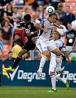 Christian Castillo (12) of D.C. United goes up for a header against Jimmy Conrad (12) of the Kansas City Wizards at RFK Stadium in Washington, DC.  D.C. United defeated the Kansas City Wizards, 2-1.