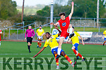 Classic FC's Max Mugambe and Tralee Dynamos Nemanja Salmardic tussle for possession in the Denny Premier A soccer league game on Sunday in Mounthawk Park.