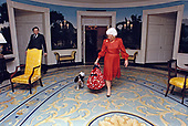 First lady Barbara Bush walks through the Diplomatic Reception Room of the White House with her dog, Millie, in Washington, DC on March 24, 1989.<br /> Mandatory Credit: Carol T. Powers / White House via CNP