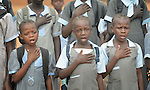 Students line up and sing the national anthem during morning assembly at the John Paul II School in Wau, South Sudan.