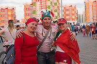 SARANSK, RUSSIA - June 25, 2018: Portugal and Iran fans pose for a photograph before their 2018 FIFA World Cup group stage match at Mordovia Arena.