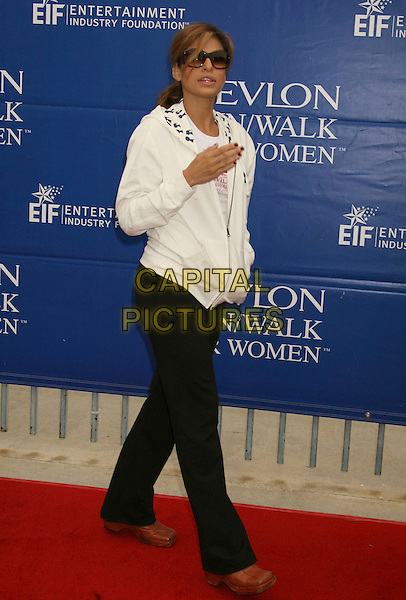 EVA MENDES.14th Annual Entertainment Industry Foundation Revlon Run/Walk For Women held at The Los Angeles Memorial Coliseum, Los Angeles, California, USA,.12 May 2007..full length white hoodie top tracksuit trousers bottoms black sporty brown shoes hand.CAP/ADM/RE.©Russ Elliot/AdMedia/Capital Pictures.