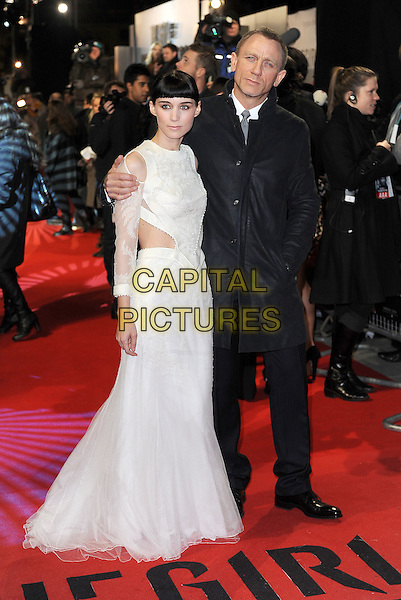 Rooney Mara and Daniel Craig.'The Girl With The Dragon Tattoo' World film Premiere, Odeon Leicester Square, London, England..12th December 2011.full length white dress sheer sleeves cut out away side fringe bangs hair side black coat jacket hand in pocket .CAP/BEL.©Tom Belcher/Capital Pictures.