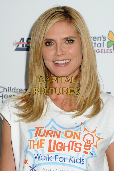 HEIDI KLUM.Children's Hospital Los Angeles 5K Walk held at Griffith Park, Los Angeles, California, USA..April 30th, 2011.headshot portrait white turn on the lights walk for kids t-shirt.CAP/ADM/BP.©Byron Purvis/AdMedia/Capital Pictures.