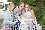 ADMIRING: Aoife OConnor, Athea, Louise.Moroney and Rebecca Brosnan, Listowel, inspect a.motorbike at the races in Athea on Saturday.