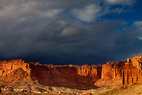 731350050 threatening storm clouds backdrop the sandstone formations near the waterpocket foldl in capitol reef national park in utah