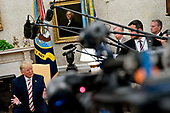 """United States President Donald J. Trump, left, speaks during a meeting with Klaus Iohannis, Romania's president, not pictured, in the Oval Office of the White House in Washington, D.C., U.S., on Tuesday, Aug. 20, 2019. Trump said today he's """"not ready to make a deal with China,"""" but adds Beijing wants an agreement and something could happen soon. <br /> Credit: Andrew Harrer / Pool via CNP"""