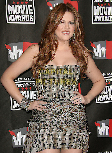 KHLOE KARDASHIAN ODOM .at The16th Annual Critics' Choice Movie Awards held at The Hollywood Palladium in Hollywood, California, USA, January 14th, 2011..half length dress hands on hips bracelets dyed red hair strapless grey gray brown print animal smiling .CAP/RKE/DVS.©DVS/RockinExposures/Capital Pictures.
