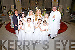 The girls from St Joseph's NS Cahersiveen who made their First Holy Communion in The O'Connell Memorial Church Cahersiveen on Saturday last were front l-r; Aine O'Connor, Karolina Krawczyk, Leah Murphy, Isabel O'Connor, back l-r; Mrs Browne, Pamela O'Connor, Laura Stanisauskaite, Molly Evans, Sophie Daly-Wilson & Canon Billy Crean.