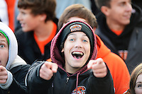 Oregon high school fans cheer their team, as Oregon tops Elkhorn 1-0 in a double-overtime victory in a boys Division 2 high school soccer sectional final on Saturday, October 26, 2013 at Waunakee High School in Waunakee, Wisconsin