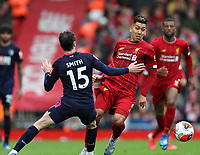 7th March 2020; Anfield, Liverpool, Merseyside, England; English Premier League Football, Liverpool versus AFC Bournemouth; Roberto Firmino of Liverpool takes on Adam Smith of Bournemouth