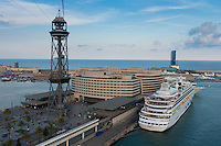 Cable car above view of Barcelona port and cruise liner