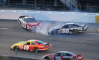May 1, 2009; Richmond, VA, USA; NASCAR Nationwide Series driver Benny Gordon (72) spins after contact with Steve Wallace (66) during the Lipton Tea 250 at the Richmond International Raceway. Mandatory Credit: Mark J. Rebilas-
