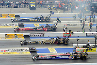 Apr. 15, 2012; Concord, NC, USA: NHRA top fuel dragster drivers (top to bottom) Brandon Bernstein , David Grubnic , Khalid Albalooshi and Dom Lagana launch off the starting line four wide during the Four Wide Nationals at zMax Dragway. Mandatory Credit: Mark J. Rebilas-