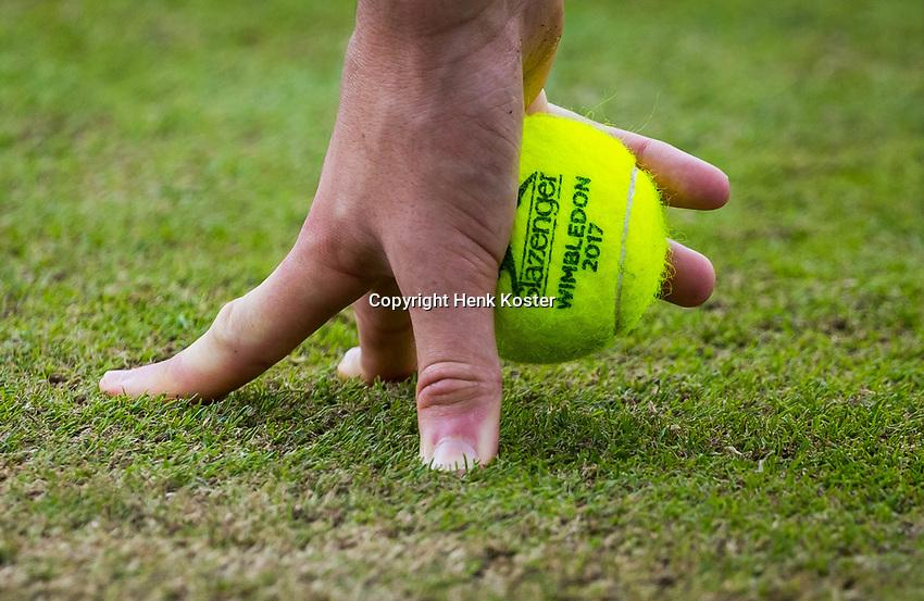 London, England, 10th July 2017. Tennis, Wimbledon. Ballboy holding ball. Photo Henk Koster, Tennis Images.