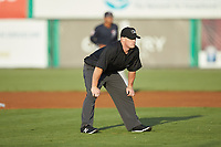 Umpire Trevor Matthews handles the calls on the bases during the Appalachian League game between the Pulaski Yankees and the Burlington Royals at Burlington Athletic Stadium on August 25, 2019 in Burlington, North Carolina. The Yankees defeated the Royals 3-0. (Brian Westerholt/Four Seam Images)