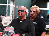 Aug. 1, 2014; Kent, WA, USA; NHRA funny car driver Gary Densham (left) and wife Joanne Densham during qualifying for the Northwest Nationals at Pacific Raceways. Mandatory Credit: Mark J. Rebilas-
