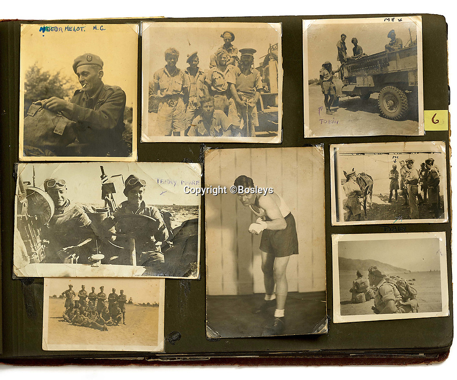 BNPS.co.uk (01202 558833)<br /> Pic: Bosleys/BNPS<br /> <br /> Fred Casey's amazing album shows the fledgling SAS at work and play in North Africa.<br /> <br /> Sold for £25,000 - An extraordinary wartime archive that lift's the veil on the earliest days of the SAS during WW2.<br /> <br /> The late Fred Casey was among the original dozen members of the 1st Special Air Service that was formed in North Africa to wreak havoc behind enemy lines.<br /> <br /> The commando's military possessions included a remarkable album containing previously unseen images of the founding members of the elite force.<br /> <br /> Legendary Captain David Stirling, who formed the 'Who Dares Wins' regiment, and hand-picked the men under his command, is pictured along with his controversial deputy Paddy Mayne , who took over the top secret regiment after Stirling's capture.<br /> <br /> The album sold at Bosley's Auctioneers of Marlow, Bucks, last week for over five times its pre-sale estimate..
