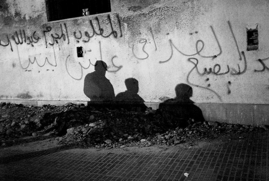 Three shadows on a wall in Benghazi, Libya.