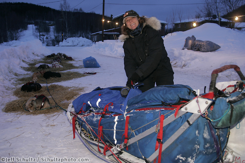 Debbie Moderow takes a break at the Tokotna checkpoint.  2005 Iditarod Trail Sled Dog Race.