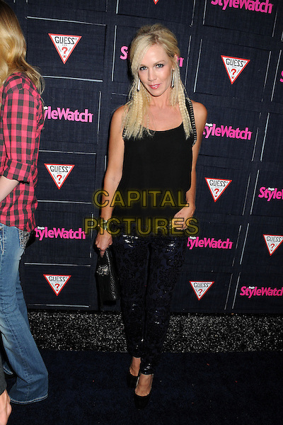 Jennie Garth.People StyleWatch hosts Hollywood Demin Party in honor of 2nd Annual Denim Issue held at Palihouse, West Hollywood, California USA..20th September 2012.full length top lace blue leather trousers hand in pocket black crimped hair .CAP/ADM/BP.©Byron Purvis/AdMedia/Capital Pictures.