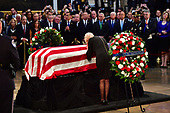 Cindy McCain leans  over the casket of former Senator John McCain in the Capitol Rotunda where he will lie in state at the U.S. Capitol, in Washington, DC on Friday, August 31, 2018. McCain, an Arizona Republican, presidential candidate and war hero died August 25th at the age of 81. He is the 31st person to lie in state at the Capitol in 166 years.    Photo by Kevin Dietsch/UPI