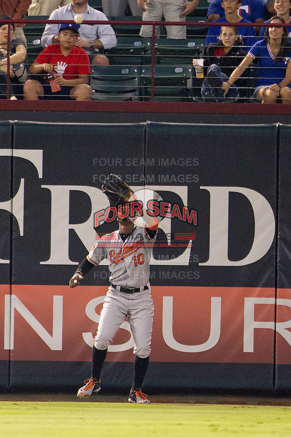 Baltimore Orioles outfielder Adam Jones #10 makes a catch during the Major League Baseball game against the Texas Rangers on August 21st, 2012 at the Rangers Ballpark in Arlington, Texas. The Orioles defeated the Rangers 5-3. (Andrew Woolley/Four Seam Images).