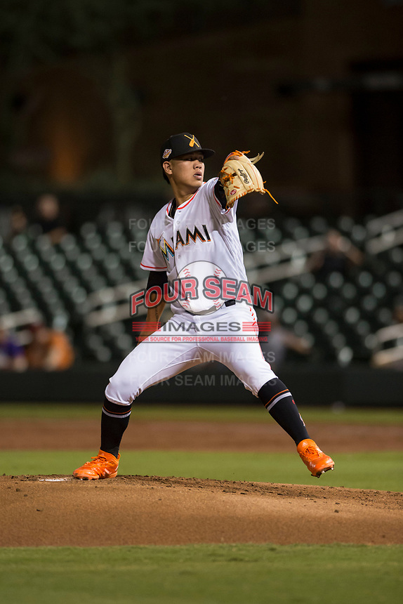 Salt River Rafters starting pitcher Jordan Yamamoto (20), of the Miami Marlins organization, delivers a pitch during an Arizona Fall League game against the Scottsdale Scorpions at Salt River Fields at Talking Stick on October 11, 2018 in Scottsdale, Arizona. Salt River defeated Scottsdale 7-6. (Zachary Lucy/Four Seam Images)