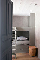 Grey hand-painted wallpaper sets the tone for this guest bedroom furnished with a contemporary bunk bed
