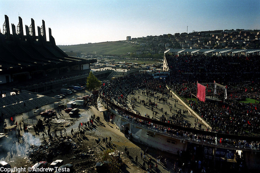 KOSOVO. Pristina. 26 Sep 2000..An election rally for the PDK, the political arm of the Kosovo Liberation Army in Pristina's football stadium..©Andrew Testa