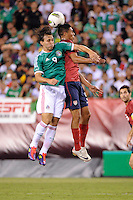 Omar Arellano (9) of Mexico and Michael Orozco Fiscal (5) of the United States go up for a header. The men's national teams of the United States (USA) and Mexico (MEX) played to a 1-1 tie during an international friendly at Lincoln Financial Field in Philadelphia, PA, on August 10, 2011.