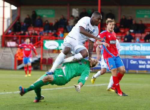 27.10.2012 Dagenham, England: ..Michael Rankine of Aldershot Town  and Chris Lewington of Dagenham & Redbridge..in action during the League Two match between Dagenham and Redbridge & Aldershot Town from The L.B Barking & Dag Stadium, Victoria Road..