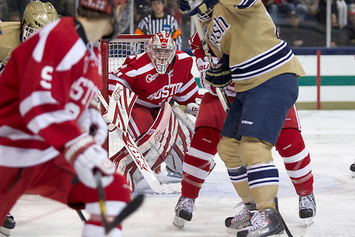 Boston University goaltender Kieran Millan (#31) looks for the puck in second period action of NCAA hockey game between Notre Dame and Boston University.  The Notre Dame Fighting Irish defeated the Boston University Terriers 5-2 in game at the Compton Family Ice Arena in South Bend, Indiana.