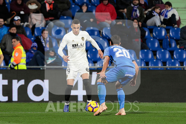 Getafe CF's Nemanja Maksimovic and Valencia CF's Rodrigo Moreno during La Liga match between Getafe CF and Valencia CF at Coliseum Alfonso Perez in Getafe, Spain. November 10, 2018.