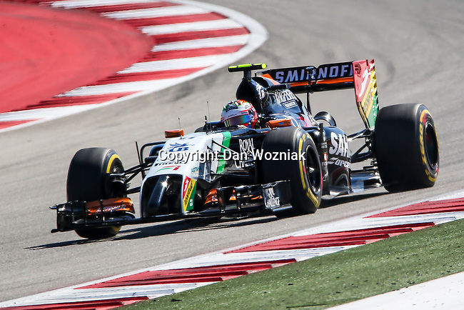 SERGIO PEREZ (11) driver of the Sahara Force India F1 Team car in action during the qualifying session before the Formula 1 United States Grand Prix race at the Circuit of the Americas race track in Austin,Texas.