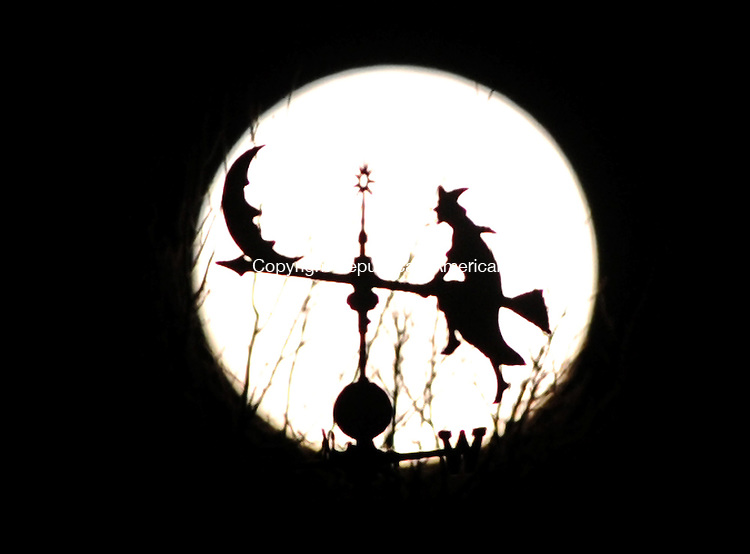LITCHFIELD, CT, 06 APRIL  2012-040612JS02-A full moon rises into the night sky on Friday behind the weathervane on top of David George's barn in the Northfield section of Litchfield. .Jim Shannon Republican-American