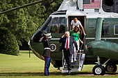 United States President Donald J. Trump disembarks from Marine One on the South Lawn with First Lady Melania Trump and his son Barron, after returning to the White House on Aug. 19, 2018 in Washington, D.C. President Trump was returning from the weekend at his Bedminster, New Jersey golf resort.    <br /> Credit: Pete Marovich / Pool via CNP