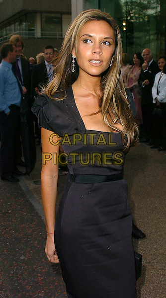 VICTORIA BECKHAM.Pride of Britain Awards 2005, London.October 10th, 2005.Ref: CAN.half length black dress.www.capitalpictures.com.sales@capitalpictures.com.©Capital Pictures