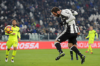 Calcio, Serie A: Juventus vs Bologna. Torino, Juventus Stadium, 8 gennaio 2017.<br /> Juventus' Gonzalo Higuain heads to score his second goal during the Italian Serie A football match between Juventus and Bologna at Turin's Juventus Stadium, 8 January 2017. Juventus won 3-0.<br /> UPDATE IMAGES PRESS/Manuela Viganti