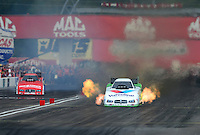 Sept. 1, 2012; Claremont, IN, USA: NHRA funny car driver Jack Beckman (right) leads teammate Johnny Gray during qualifying for the US Nationals at Lucas Oil Raceway. Mandatory Credit: Mark J. Rebilas-